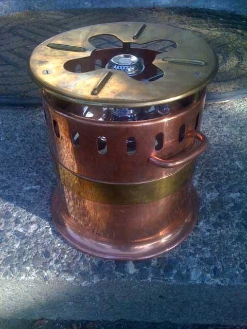 1311215213-copper_brass_stove1a.jpg